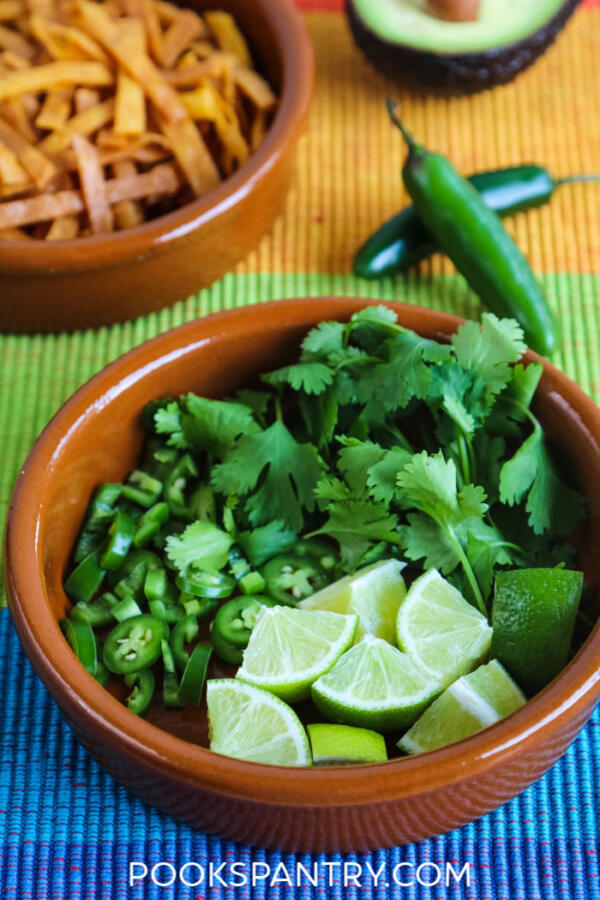 Cilantro, chilies and lime for tortilla soup