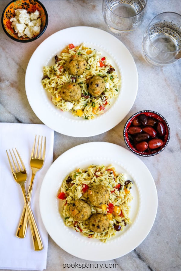 Greek chicken meatballs with orzo on white plates