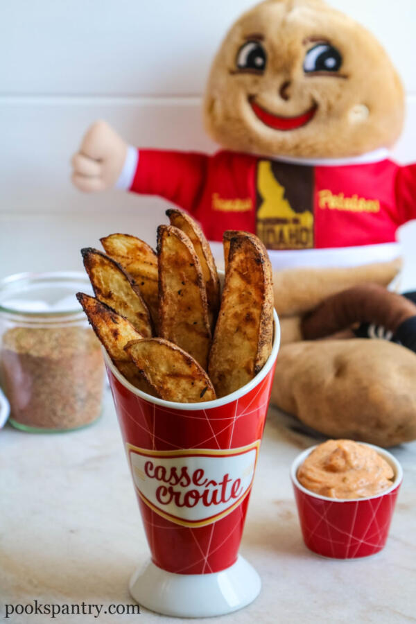 grilled potato wedges in serving cup