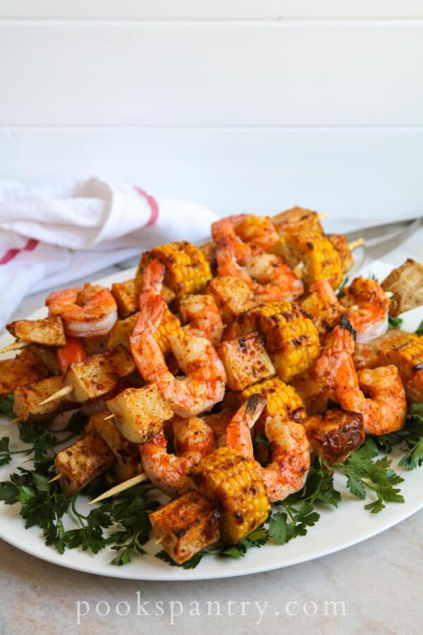 cajun shrimp and potato skewers with corn