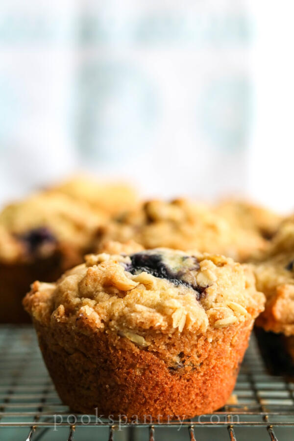 blueberry peach muffin with streusel on cooling rack