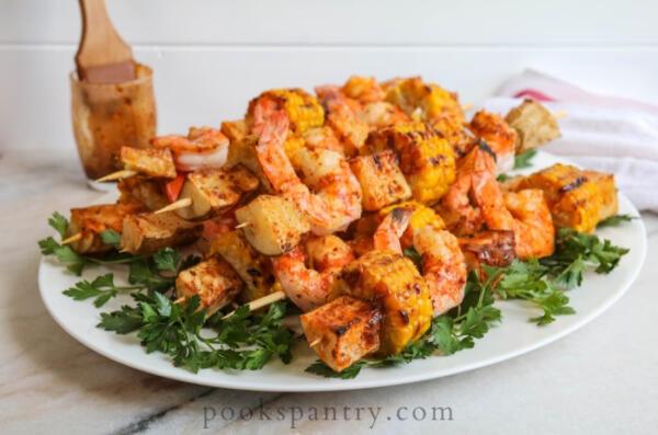 grilled cajun shrimp skewers on platter