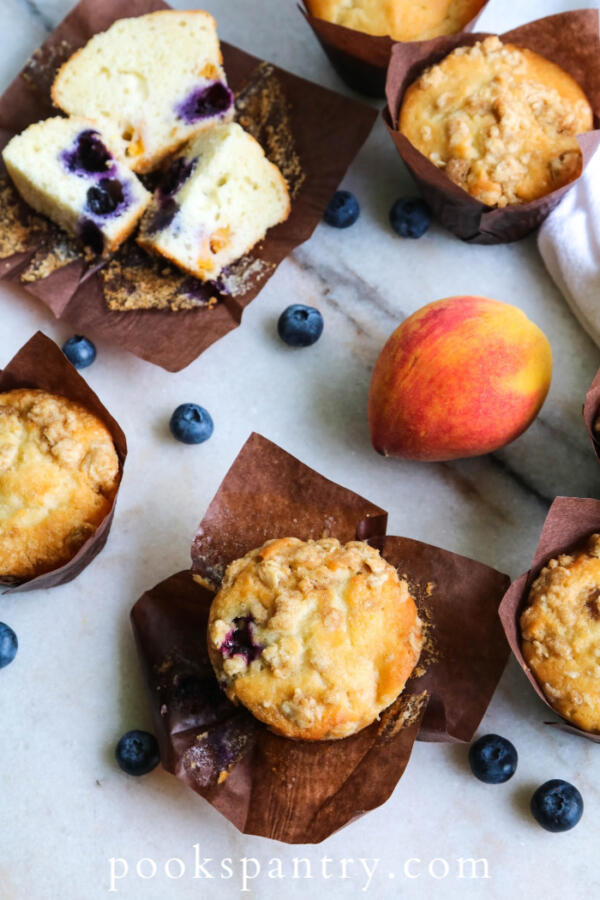 peach blueberry muffins on countertop