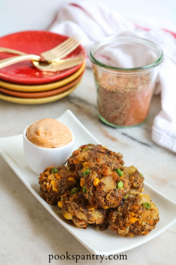 vegan vegetable cakes on white platter