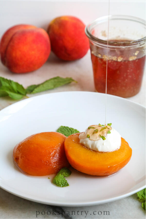 drizzling syrup on peaches