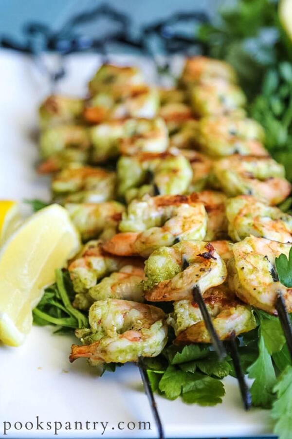 grilled shrimp skewers on white platter