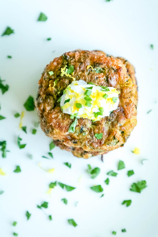 stacked fritters with sour cream, herbs and lemon zest