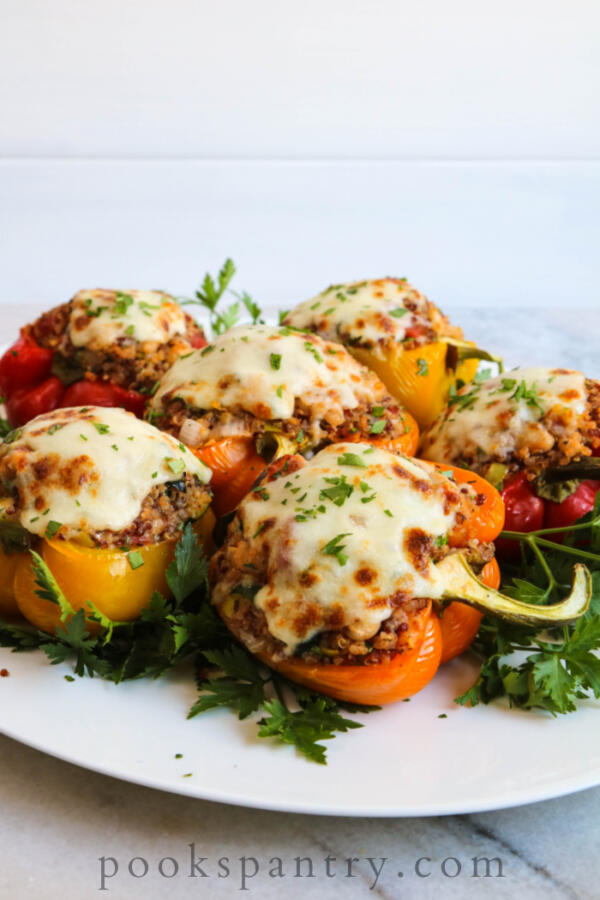 Italian vegetarian stuffed peppers on white platter