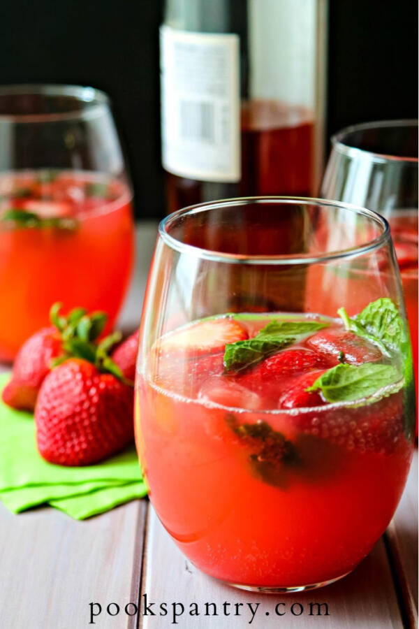 watermelon smash with strawberries and mint in stemless wine glass