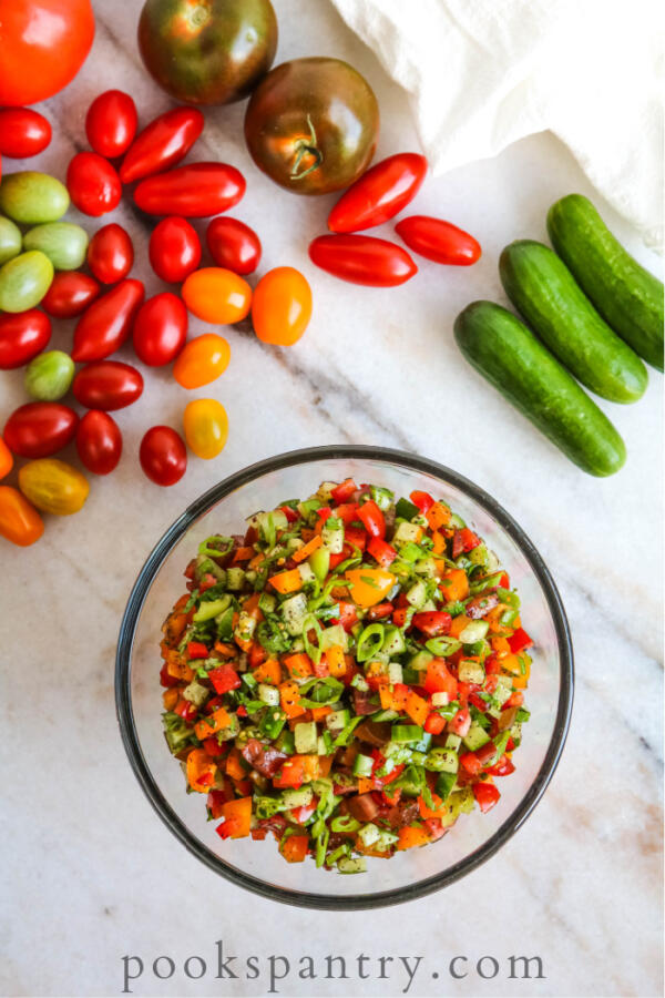 overhead view of Israeli salad with tomatoes and cucumbers