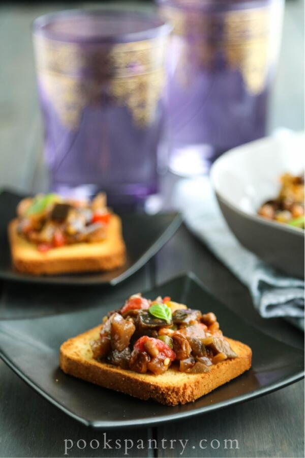 caponata bruschetta on black plate