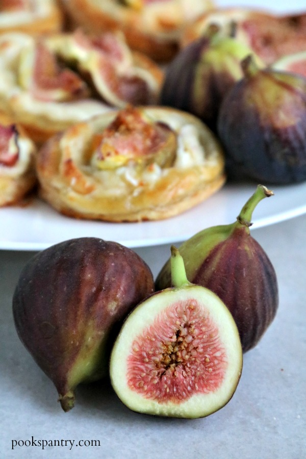 sliced fig with fig tarts in background