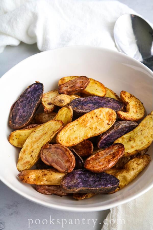 Roasted fingerling potatoes in white bowl