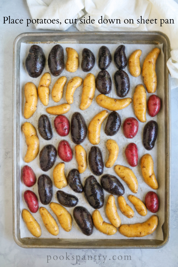 red, yellow and purple fingerling potatoes on sheet pan