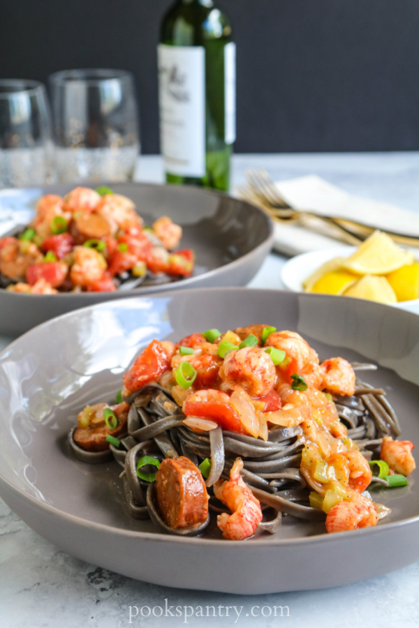 langostino andouille pasta in gray bowl