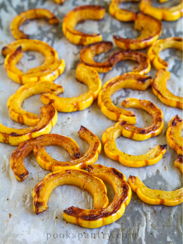 roasted slices of Delicata squash for salad