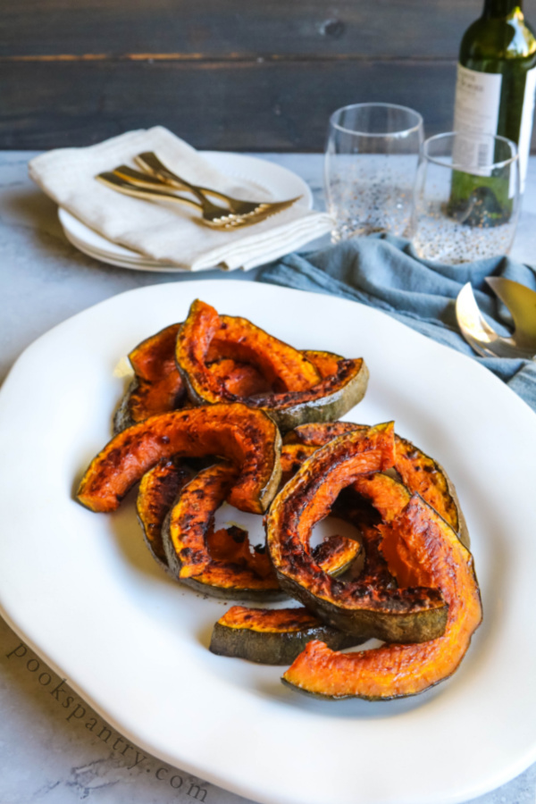 How to bake Hubbard squash in the oven - plattered on white plate.