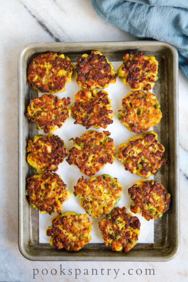 curried cauliflower cakes on baking sheet