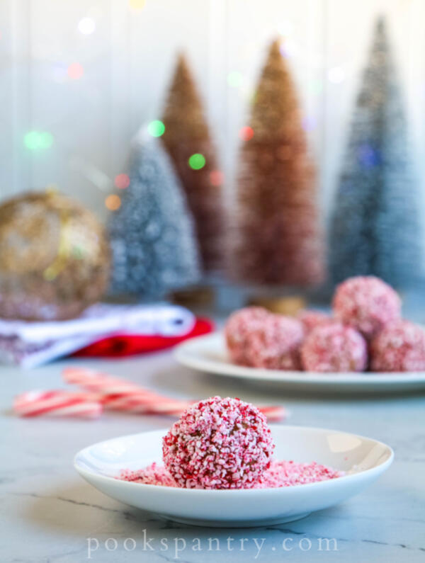 rum balls with crushed candy canes on small white plate