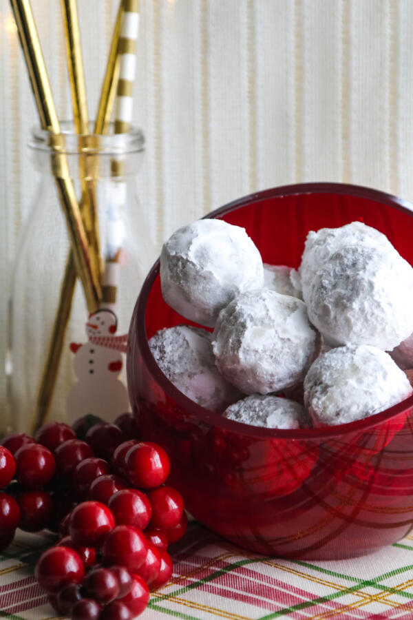 rum balls in round red bowl with cream background