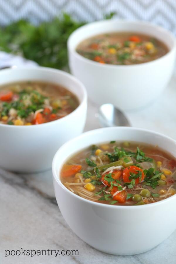 bowls of slow cooker chicken vegetable soup