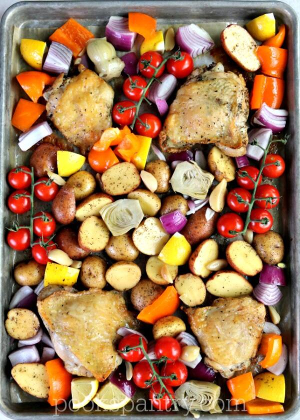 mediterranean chicken thighs with vegetables on sheet pan