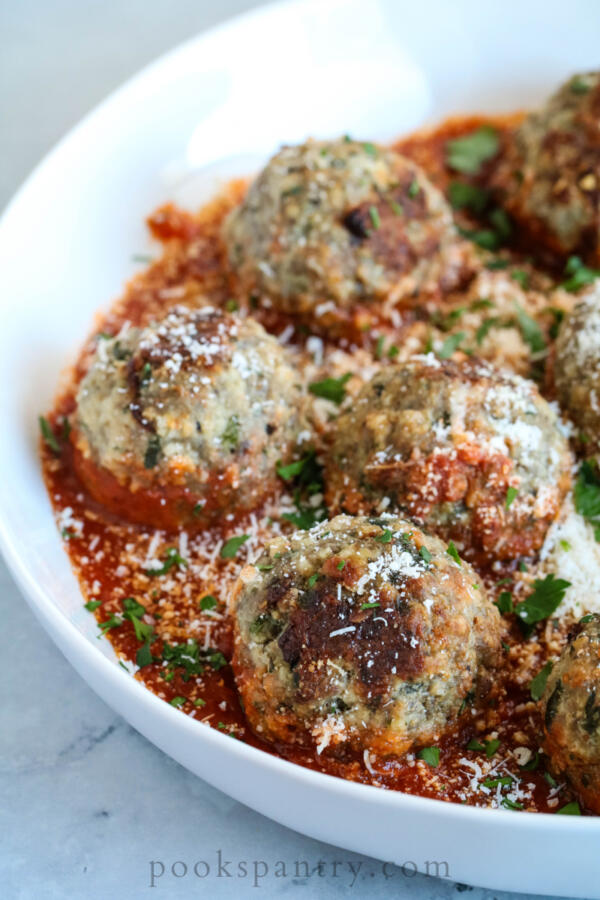 easy weeknight meatballs in tomato sauce with fresh parsley and cheese