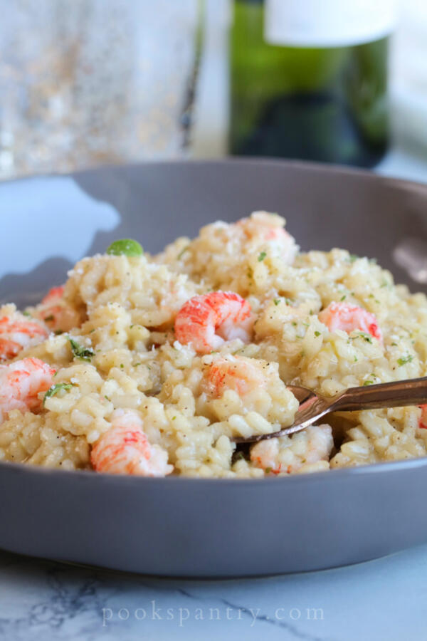 langostino lobster risotto in gray bowl with rose gold spoon
