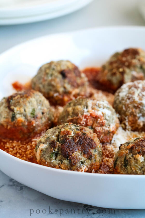 meatballs in tomato sauce with mozz and parm
