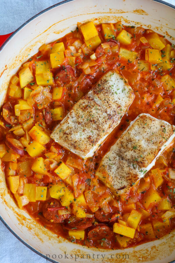 overhead view of corvina with linguica and potatoes
