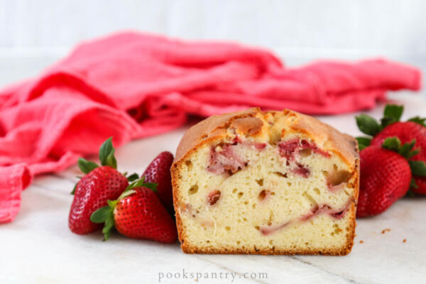 pound cake with strawberries and pink napkin