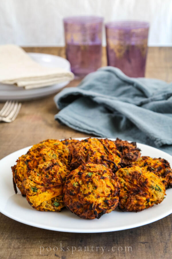 air fryer butternut squash fritters on round white plate