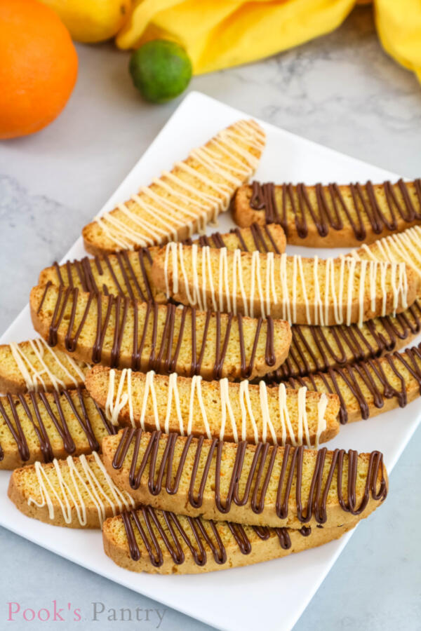 Italian cookies on plate with chocolate drizzle