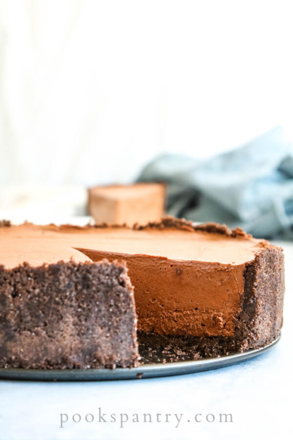 no bake chocolate cheesecake with one slice removed