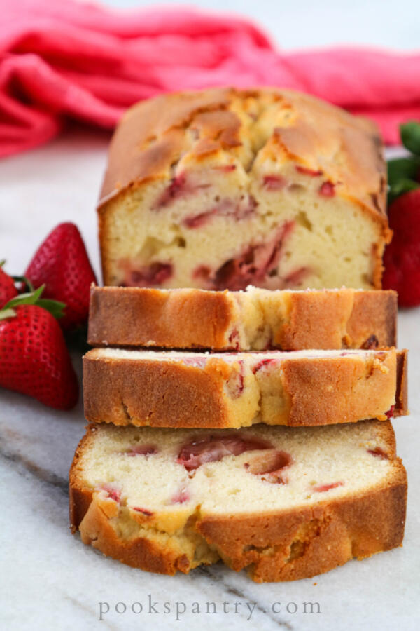 cream cheese pound cake with strawberries on marble board