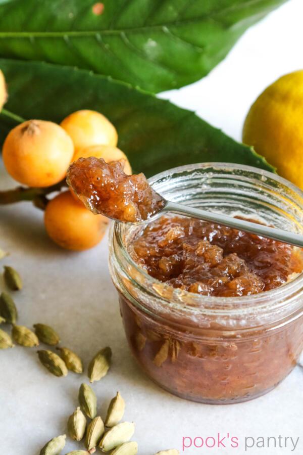 Japanese plum jam with cardamom on marble countertop.