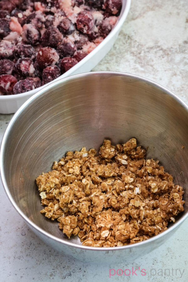 Oat topping for crisp in mixing bowl.