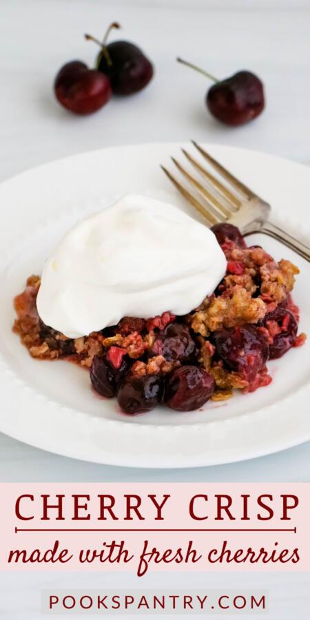 Cherry crisp with fork on white plate image for Pinterest.
