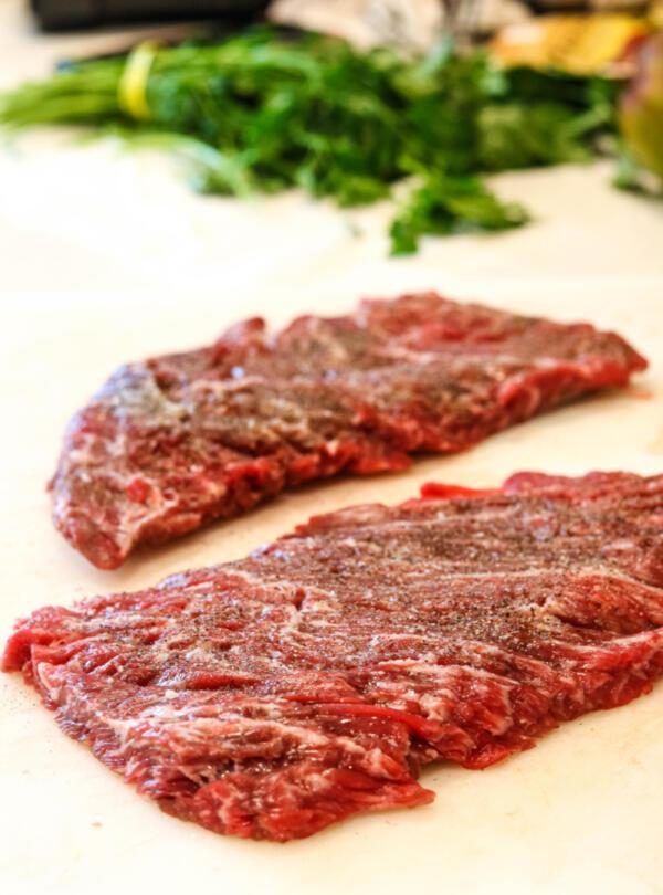 Raw bavette sirloin steak on cutting board.