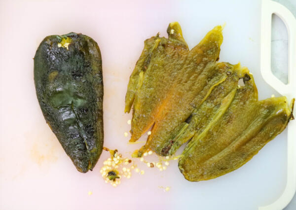 Peeling poblano peppers for rajas recipe.