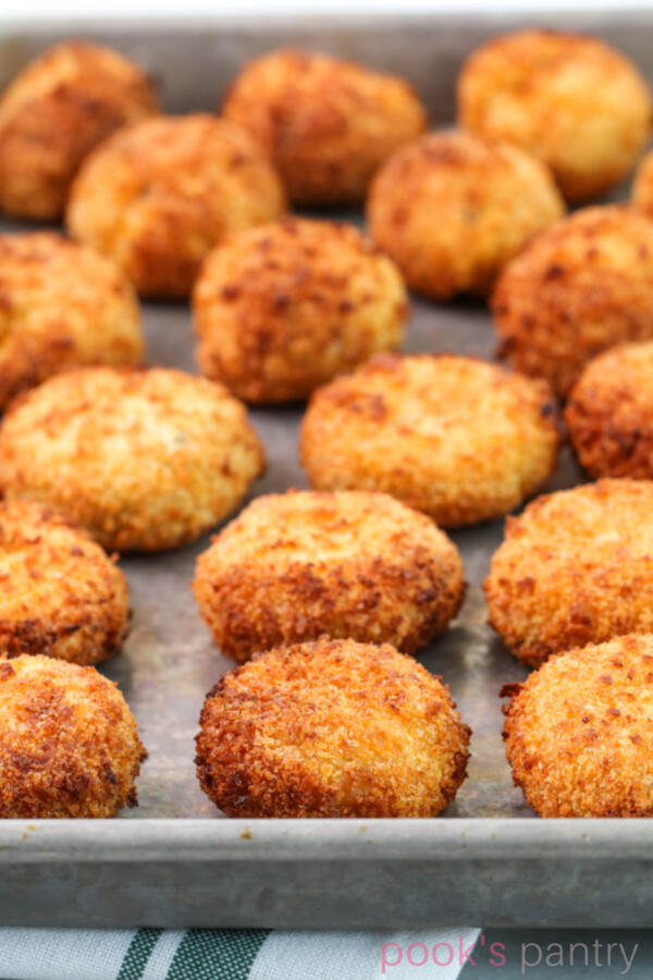 Crunchy air fryer risotto cakes on sheet pan.