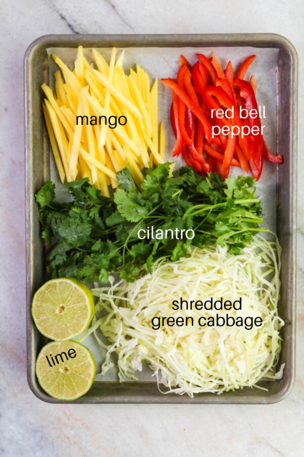 Ingredients for mango slaw on sheet pan.