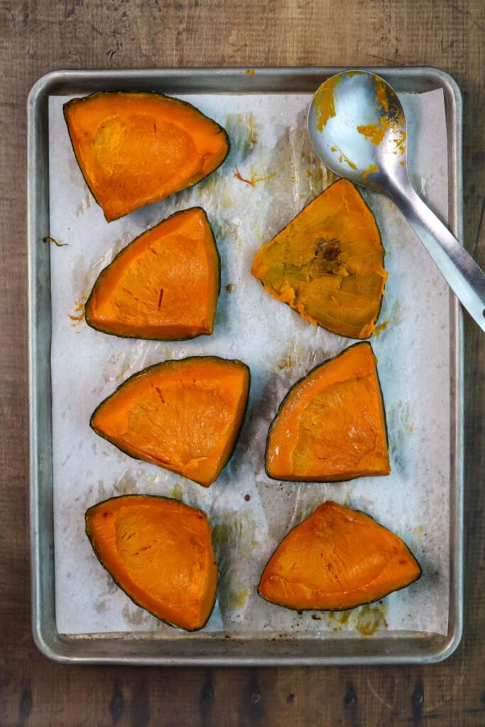 Roasting pumpkin for empanadas de calabaza.