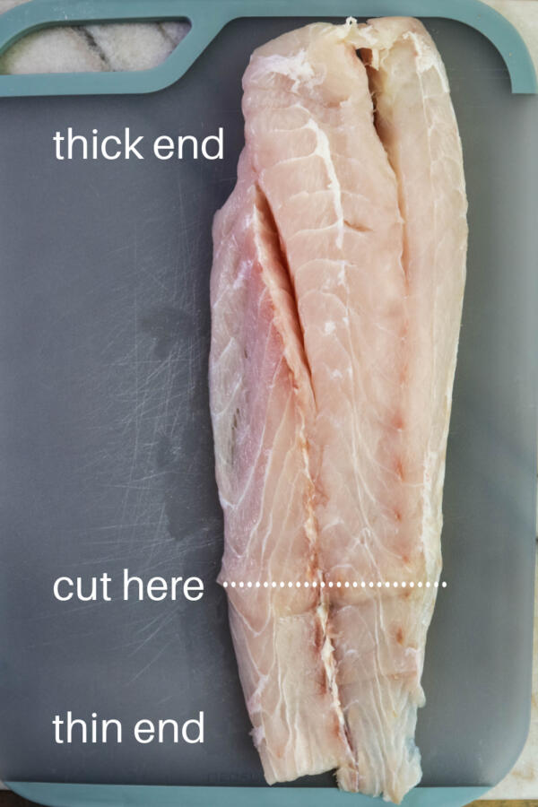 Side of corvina fish ready to cut into portions.