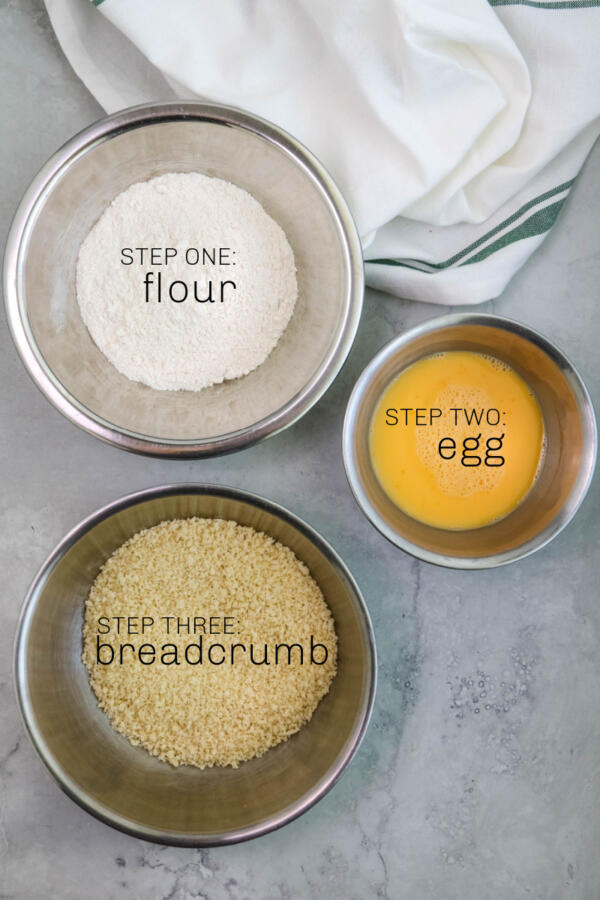 Standard breading procedure of flour, egg and breadcrumb in separate bowls.