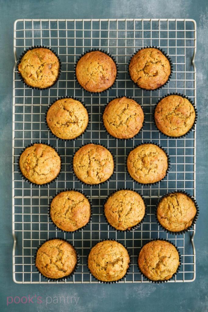 Squash muffins cooling on rack.