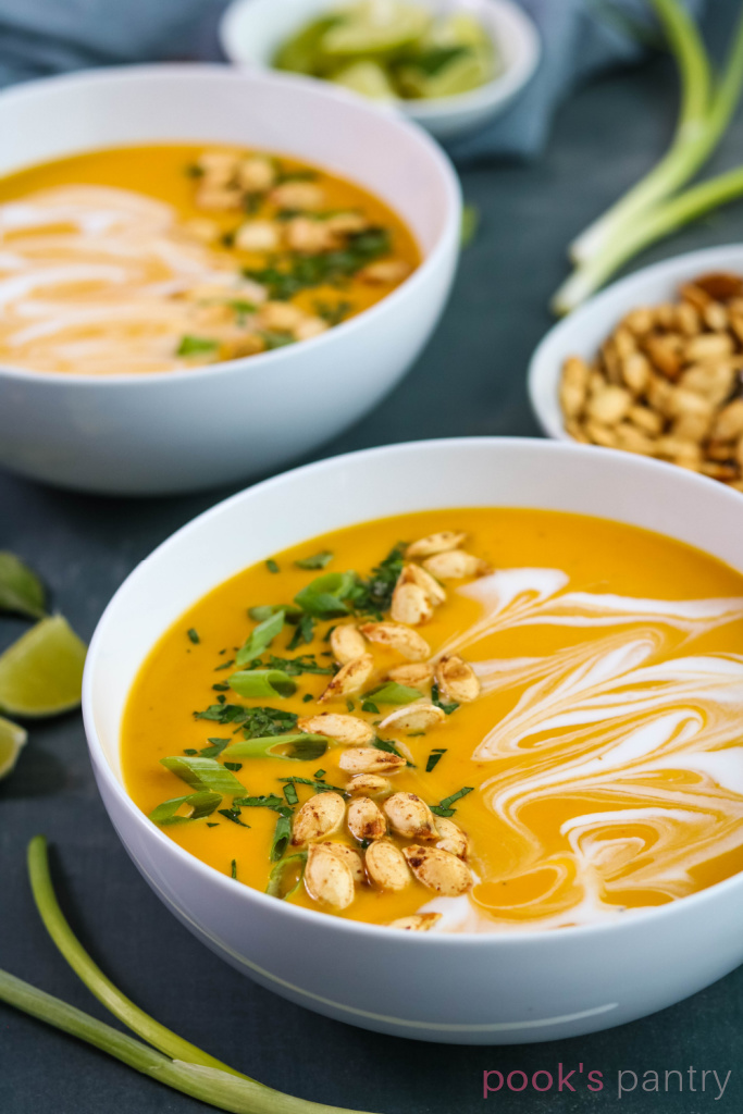 Bowls of coconut curry Hubbard soup.
