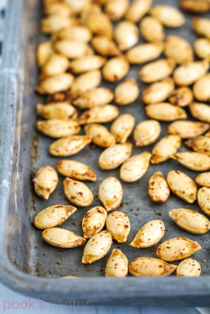 Roast Hubbard squash seeds on baking sheet.