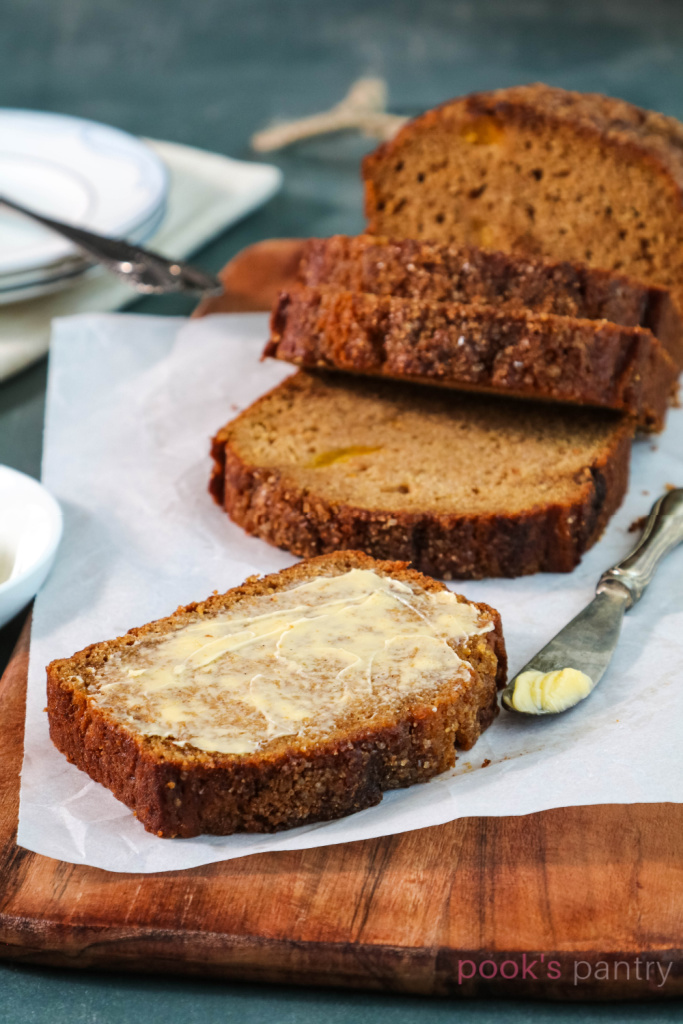 Buttered Hubbard squash bread on parchment paper.