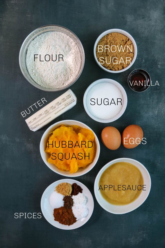 Ingredients for Hubbard squash bread on blue background.